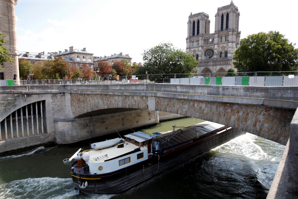 Fences surround Notre-Dame Cathedral in preparation for lead decontamination operation, in Paris France on August 13, 2019. Photo by Charles Platiau/Reuters