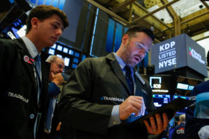 Traders work on the floor at the New York Stock Exchange (NYSE) in New York, on August 13, 2019. Photo by Eduardo Munoz/Reuters