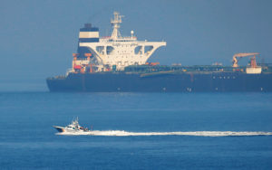 A Spanish Civil Guard boat sails past Iranian oil tanker Grace 1 as it sits anchored after it was seized in July by British Royal Marines off the coast of the British Mediterranean territory on suspicion of violating sanctions against Syria, in the Strait of Gibraltar, southern Spain August 13, 2019. REUTERS/Jon NazcaA Spanish Civil Guard boat sails past Iranian oil tanker Grace 1 as it sits anchored after it was seized in July by British Royal Marines off the coast of the British Mediterranean territory on suspicion of violating sanctions against Syria, in the Strait of Gibraltar, southern Spain August 13, 2019. REUTERS/Jon Nazca