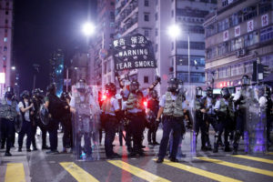 Police stand at a junction in the Sham Shui Po neighbourhood during clashes with anti-extradition bill protesters in Hong Kong, China, August 14, 2019. Photo by Thomas Peter/Reuters