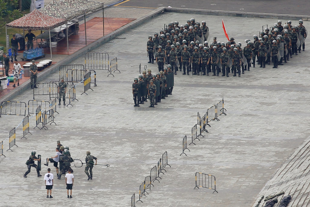 Chinese servicemen attend a crowd control exercise at the Shenzhen Bay Sports Center in Shenzhen across the bay from Hong ...
