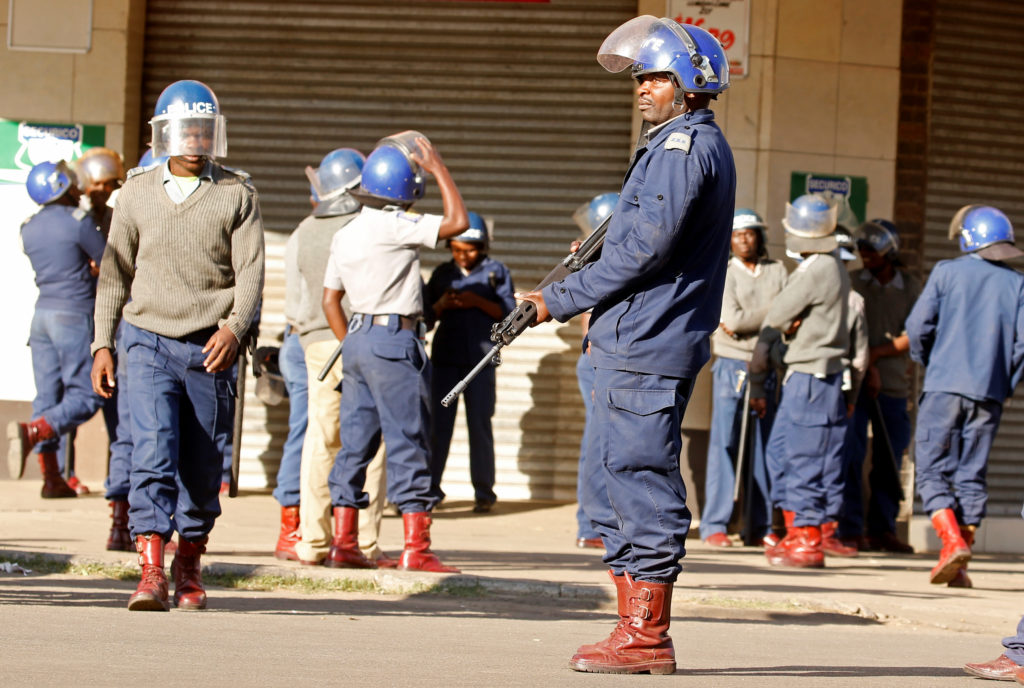 Riot police patrol the streets after police earlier banned planned protests by the opposition party Movement for Democratic Change (MDC) in Harare, Zimbabwe, August 16, 2019. Photo by Philimon Bulawayo/Reuters