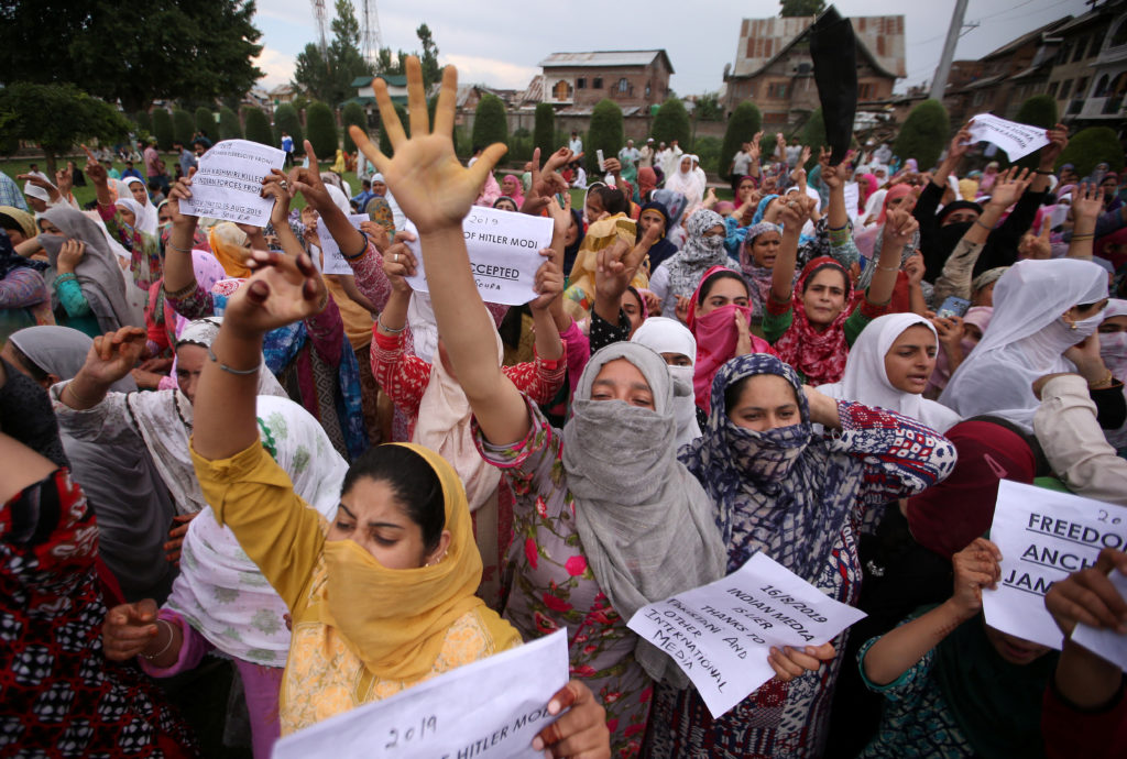 Kashmiri women shout slogans at a protest after Friday prayers duri…