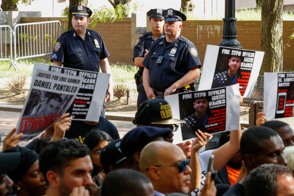 NYPD officers stand guard as people attend a press conference of Gwen Carr, mother of Eric Garner outside Police Headquarters in New York, on August 19, 2019. Photo by Eduardo Munoz/Reuters