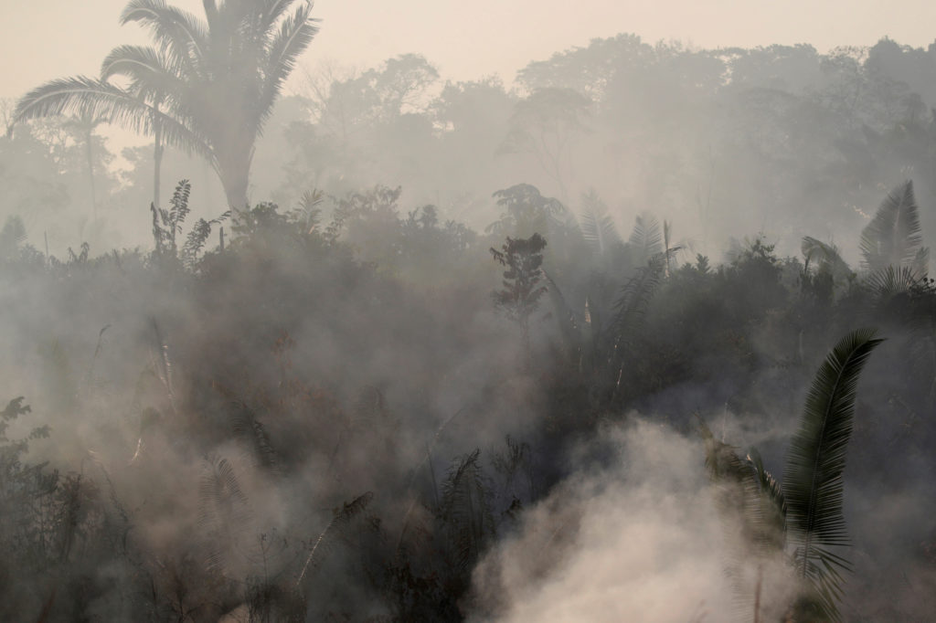 Smoke billows during a fire in an area of the Amazon rainforest near Humaita, Amazonas State, Brazil, Brazil on August 14, 2019. Photo by Ueslei Marcelino/Reuters