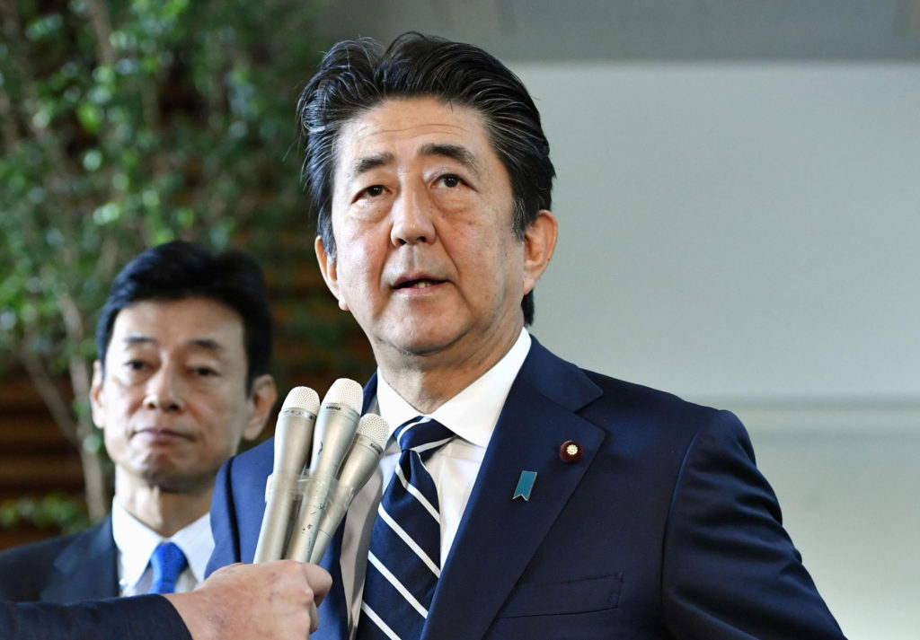 Japan's Prime Minister Shinzo Abe speaks to media at his official r…