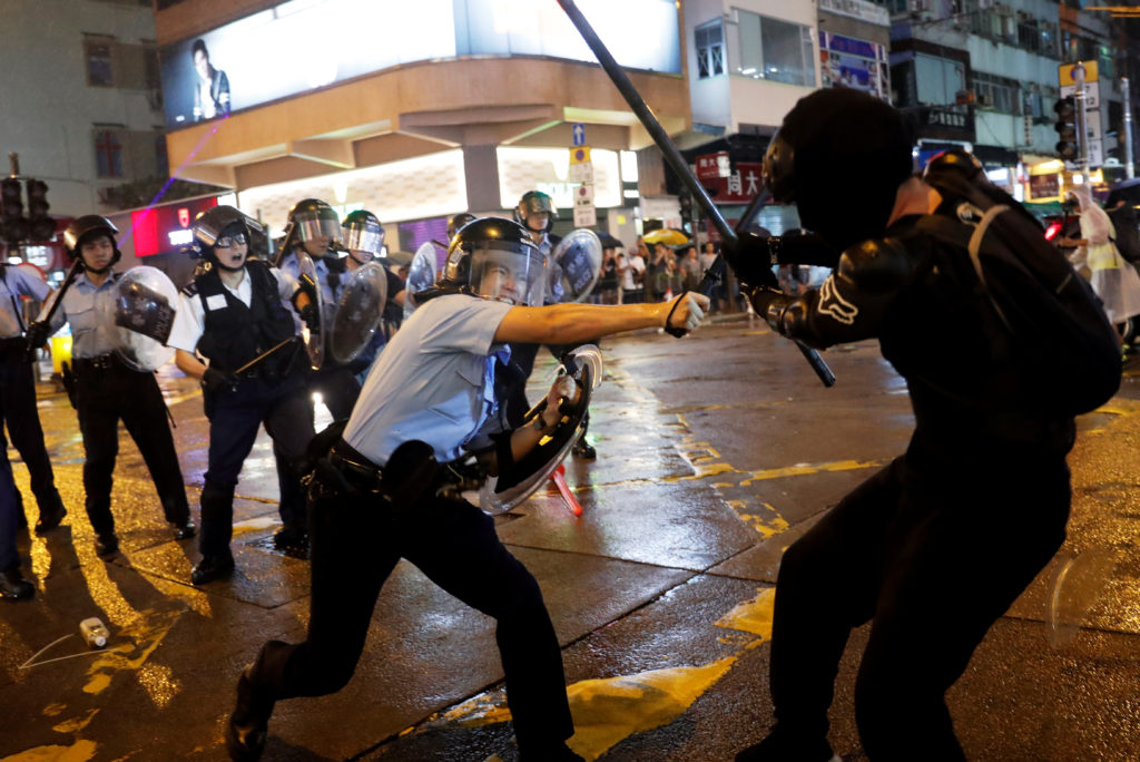 Police clash with anti-extradition bill protesters after a protest,…