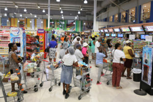 Shoppers preparing for the arrival of Tropical Storm Dorian crowd a supermarket in Bridgetown, Barbados August 25, 2019. Photo by Nigel R Browne/Reuters