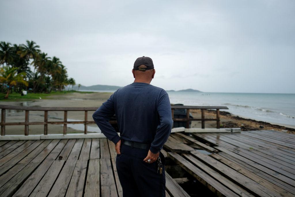A man surveys the beach as Tropical Storm Dorian approaches in Huma…