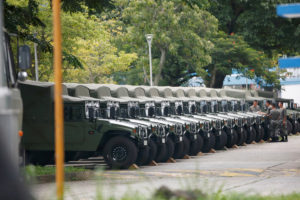 Troops are seen by a row of over a dozen army jeeps at the Shek Kong military base of People's Liberation Army (PLA) in New Territories, Hong Kong, China August 29, 2019. Photo by Reuters Staff