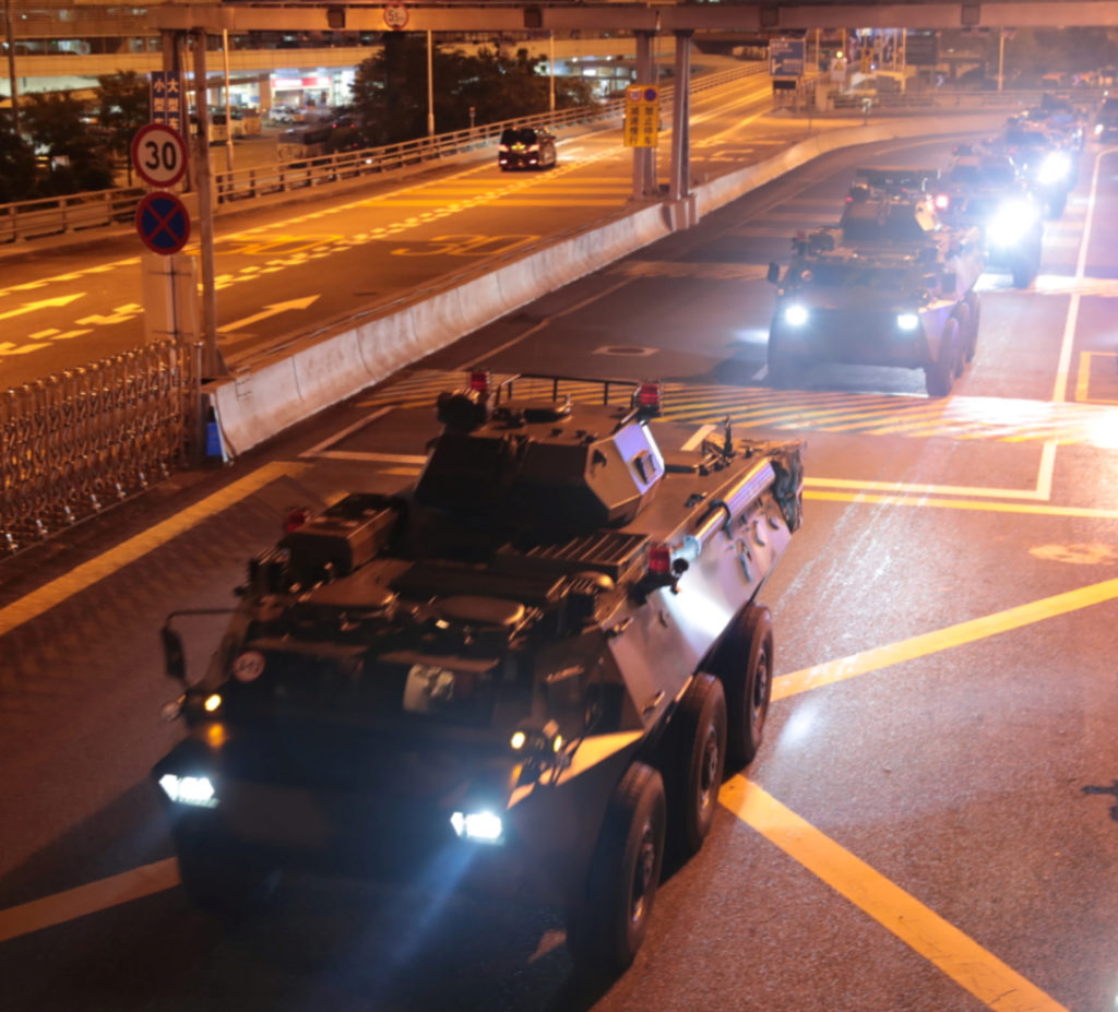 Military vehicles of the Chinese People's Liberation Army (PLA) pass Huanggang Port for a routine troop rotation in Hong Kong, August 29, 2019. Photo by Xinhua via Reuters