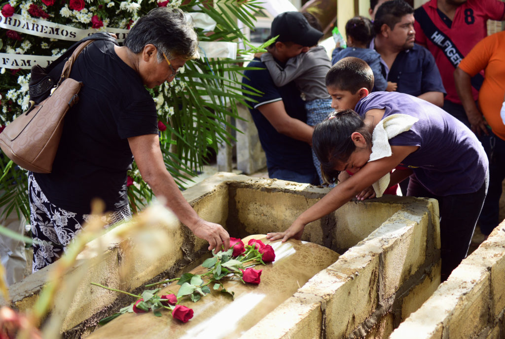 "Relatives and friends react next to the coffin of Zuleima Hernandez, who died after an arson attack by suspected gang members at ""El Caballo Blanco"" bar, during his funeral at the Panteon cemetery in the southern Mexican port of Coatzacoalcos, Mexico August 29, 2019. Photo by Oscar Martinez/Reuters"