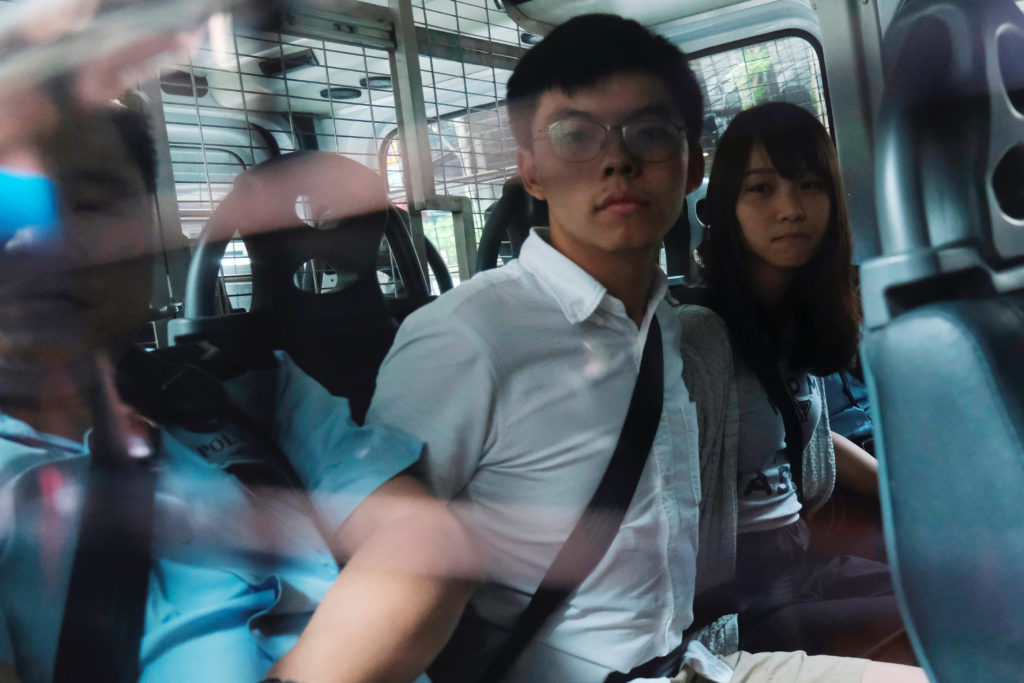 Pro-democracy activists Joshua Wong and Agnes Chow arrive at the Ea…