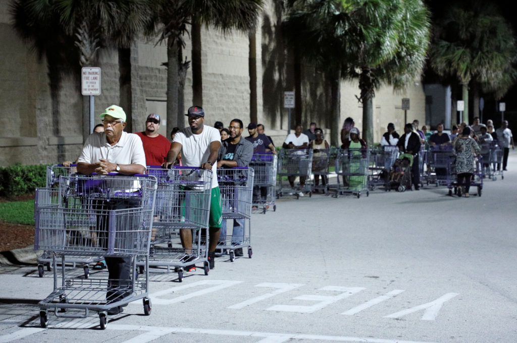 Shoppers wait in a long line for a Sam's Club store to open before sunrise, as people rushed to buy supplies ahead of the arrival of Hurricane Dorian in Kissimmee, Florida, on August 29, 2019. Photo by Gregg Newton/Reuters