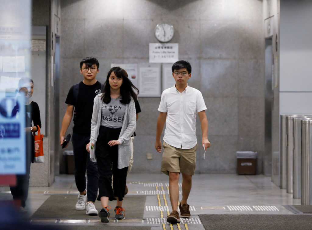 Pro-democracy activists Joshua Wong and Agnes Chow leave the Eastern Court after being released on bail in Hong Kong, China on August 30, 2019. Photo by Anushree Fadnavis/Reuters