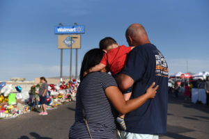 Norma, Luke and Mark Jimerson pay their respects at a memorial four days after a mass shooting at a Walmart store in El Paso, Texas, U.S. August 7, 2019. Photo by Callaghan O'Hare/Reuters