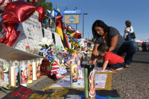 Norma and Luke Jimerson pay their respects at a memorial four days after a mass shooting at a Walmart store in El Paso, Texas, U.S. August 7, 2019. REUTERS/Callaghan O'Hare
