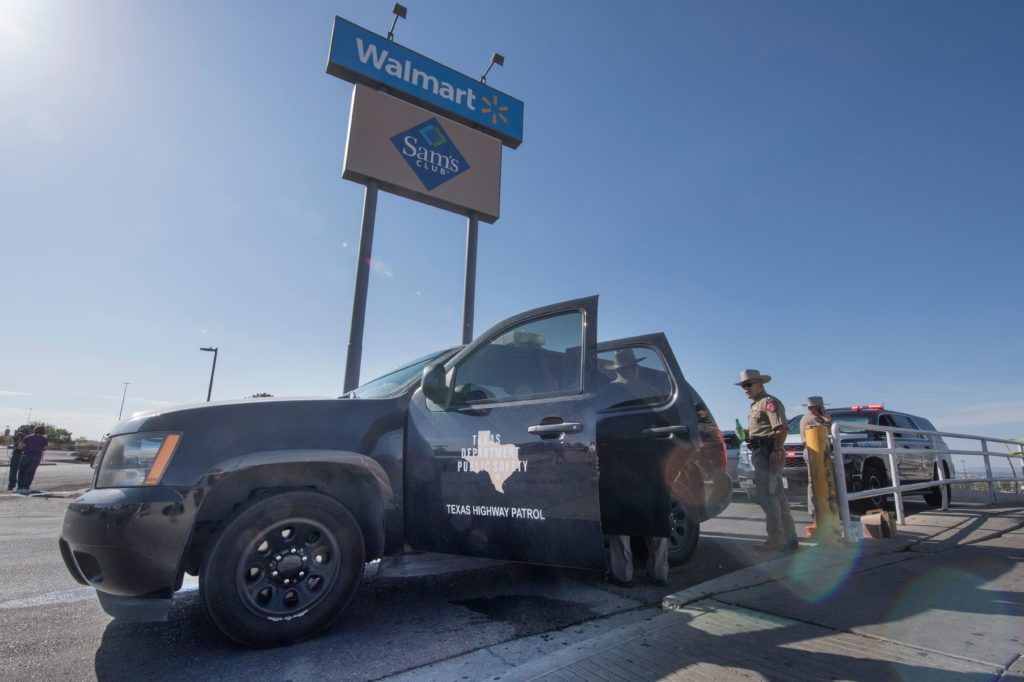 "Texas State Troopers keep watch outside the Cielo Vista Mall Wal-Mart where a shooting left 20 people dead in El Paso, Texas, on August 4, 2019. - Texas authorities are investigating the Saturday mass shooting at a Walmart store in El Paso as a possible hate crime, the city's police chief said, as authorities study an online manifesto linked to the suspect. A 21-year-old from Allen, a suburb of Dallas, surrendered to police outside the store after the rampage that left 20 people dead and 26 wounded.US media identified him as Patrick Crusius, who is white, and linked him to a ""manifesto"" posted online that includes passages railing against the ""Hispanic invasion"" of Texas. Photo by Mark Ralston/AFP/Getty Images"
