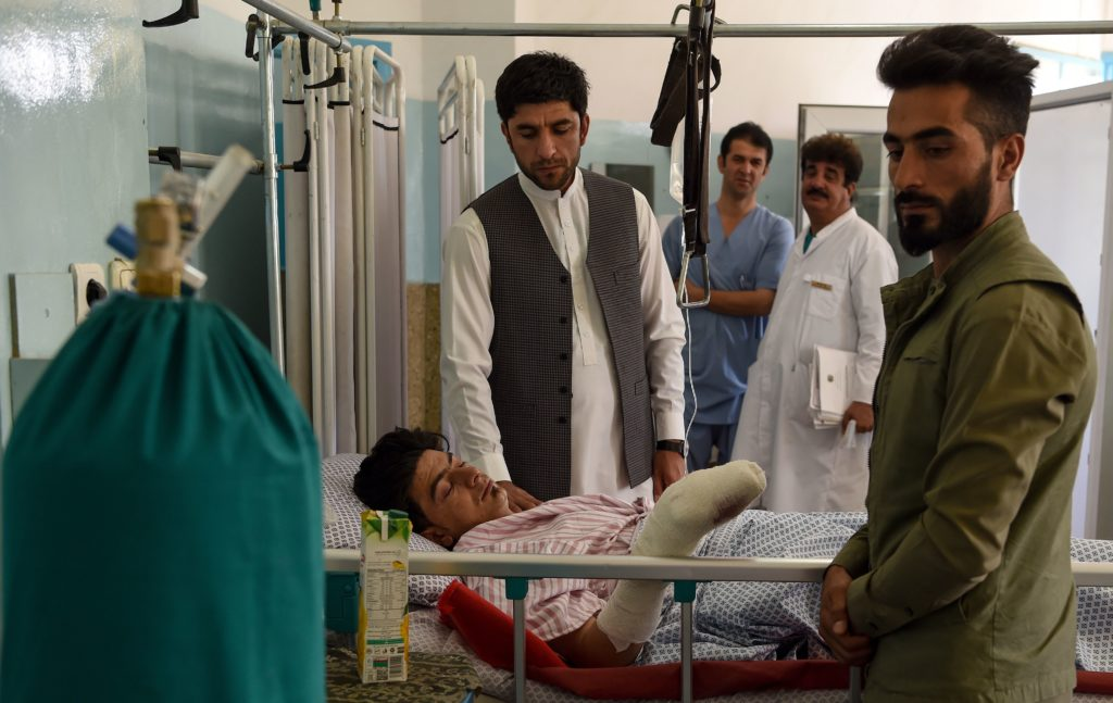 News Wrap: Afghans mourn victims of wedding bombing