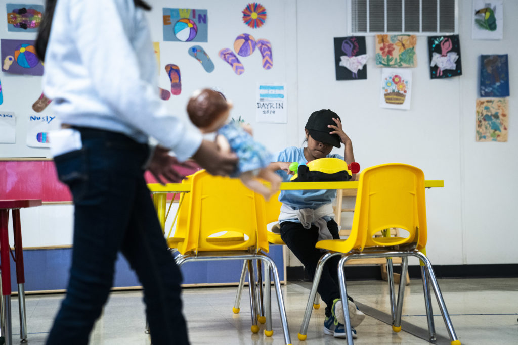 Immigrant children play with toys in a daycare as U.S. Immigration and Customs Enforcement (ICE) and Enforcement and Remov...