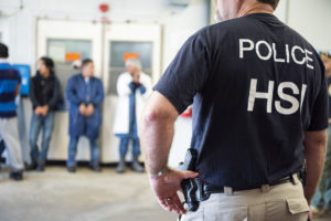 Homeland Security Investigations (HSI) officers from Immigration and Customs Enforcement (ICE) look on after executing search warrants and making some arrests at an agricultural processing facility in Canton, Mississippi, U.S. in this August 7, 2019 handout photo. Photo by Immigration and Customs Enforcement/Handout via REUTERS