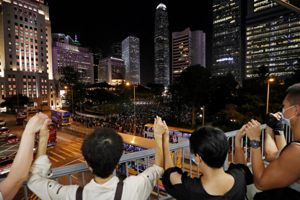 News Wrap: Democracy supporters in Hong Kong form human chain extending 25 miles