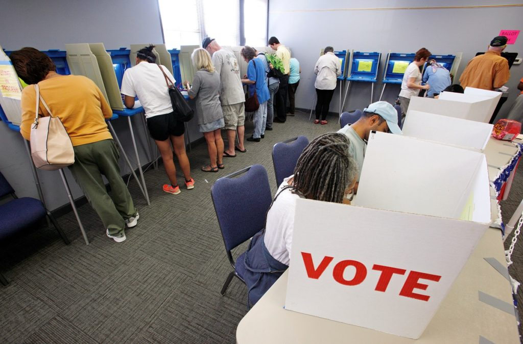 People cast their ballots for the 2016 general elections at a crowded polling station as early voting begins in North Carolina, in Carrboro, North Carolina, U.S., October 20, 2016. Photo by Jonathan Drake/Reuters