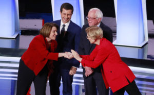 U.S. Senator Amy Klobuchar, South Bend Mayor Pete Buttigieg, U.S. Senator Bernie Sanders and U.S. Senator Elizabeth Warren (L-R) greet each other on the first night of the second 2020 Democratic U.S. presidential debate in Detroit on July 30. Photo by Lucas Jackson/Reuters