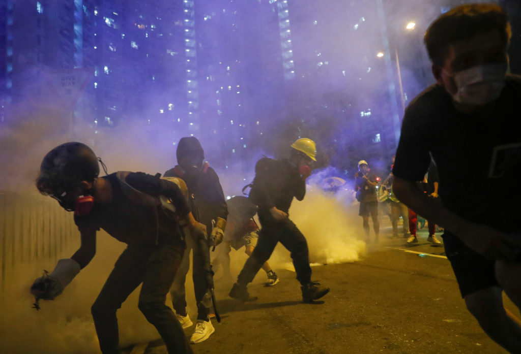 Hong Kong protesters toss Chinese flag, clash with police
