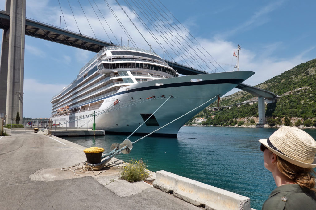 In Europe, business booms when cruise ships arrive — but is it worth the bother?