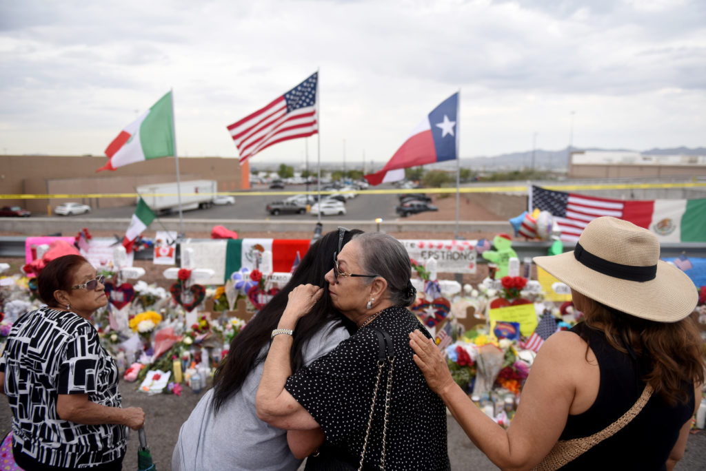 People gather to pay their respects at a memorial three days after a mass shooting at a Walmart store in El Paso, Texas, U.S. August 6, 2019.  REUTERS/Callaghan O'Hare