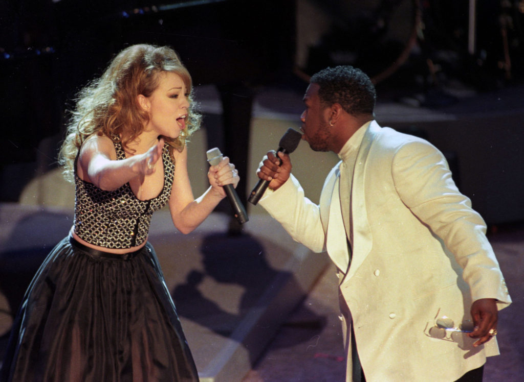 "Mariah Carey performs ""One Sweet Day"" with Wayna Morris of Boyz II Men at the 38th annual Grammy Awards on February 28, 1996 in Los Angeles. Photo by Reuters/Gary Hershorn /Landov"