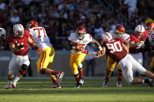 FILE PHOTO: University of Southern California running back Silas Redd (center) runs against Stanford University's Shayne Skov (L) and Josh Mauro during the second quarter of their NCAA football game in Palo Alto, California September 15, 2012. California has become the first state to allow athletes to be paid for endorsements. Photo by Robert Galbraith/ReutersFILE PHOTO: University of Southern California running back Silas Redd (center) runs against Stanford University's Shayne Skov (L) and Josh Mauro during the second quarter of their NCAA football game in Palo Alto, California September 15, 2012. California has become the first state to allow athletes to be paid for endorsements. Photo by Robert Galbraith/Reuters