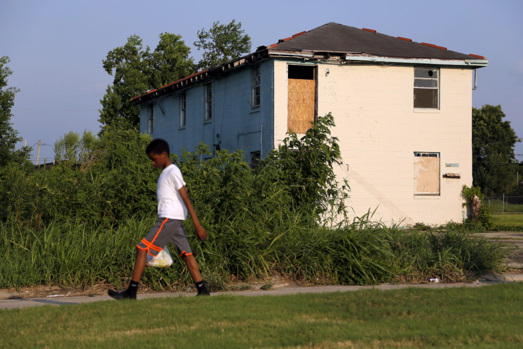 A young boy walks past an abandoned house in the Lower Ninth Ward neighborhood of New Orleans, Louisiana, July 31, 2015. The areas with the most income inequality last year included Louisiana, according to Census data. Photo by Jonathan Bachman/Reuters
