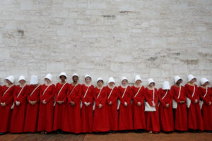 "Women dressed as handmaids promoting the Hulu original series ""The Handmaid's Tale"" stand along a public street during the 2017 South by Southwest (SXSW) Music Film Interactive Festival 2017 in Austin, Texas. Photo by Brian Snyder/Reuters"