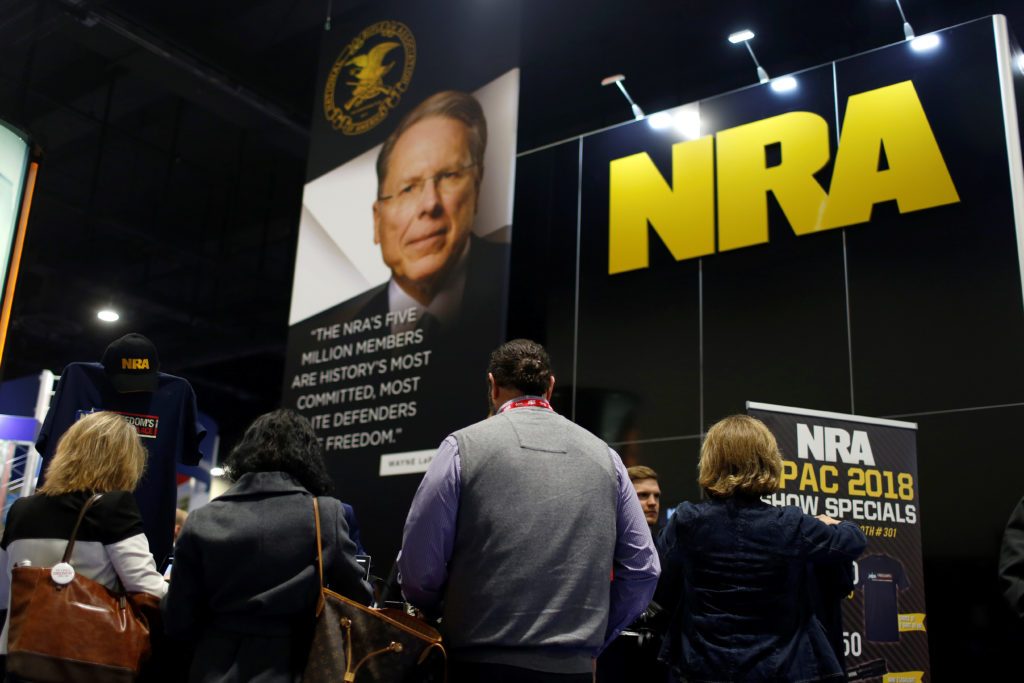 People sign up at the booth for the National Rifle Association (NRA) at the Conservative Political Action Conference (CPAC...