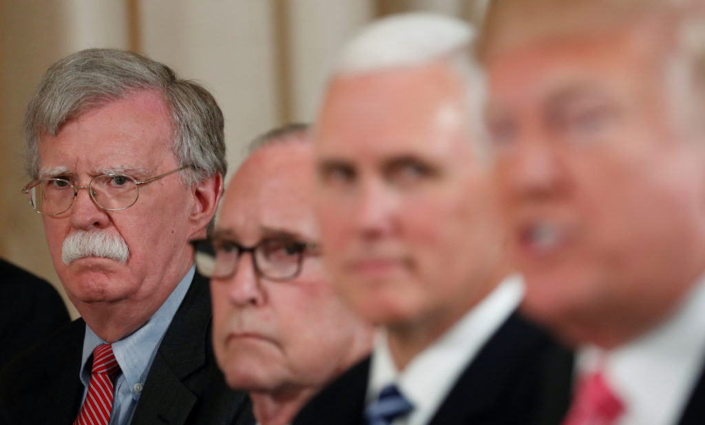 U.S. President Donald Trump (far right) speaks while seated with national security adviser John Bolton (far left), White House economic adviser Larry Kudlow (2nd left) and Vice President Mike Pence (2nd right), while hosting a working luncheon with Japan's Prime Minister Shinzo Abe at Trump's Mar-a-Lago estate in Palm Beach, Florida on April 18, 2018. Photo by Kevin Lamarque/Reuters