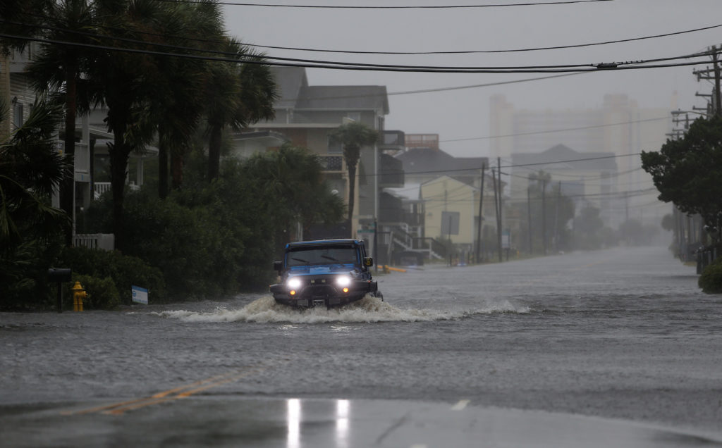 A vehicle navigates a flooded Ocean Boulevard during Hurricane Florence in North Myrtle Beach, South Carolina, on September 14, 2018. One year later, the community is facing feet of storm surge from Hurricane Dorian. Photo by Randall Hill/Reuters