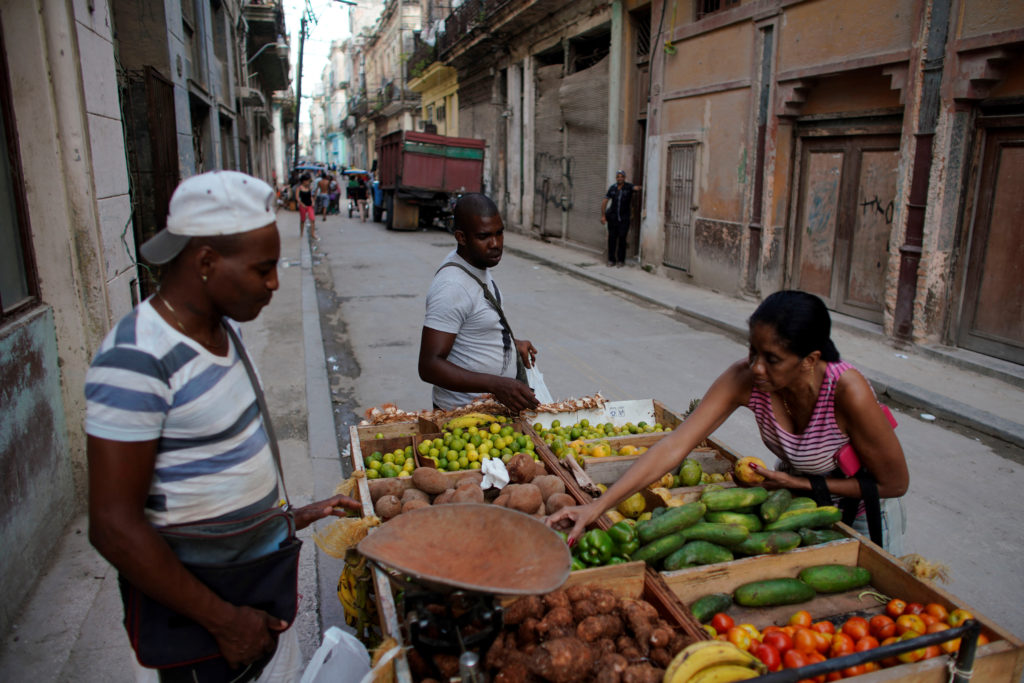 Self-employed Yuqui Morales sells vegetables from a cart in downtown Havana, Cuba May 16, 2019. Photo by Alexandre Meneghi...