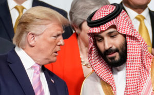 President Donald Trump speaks with Saudi Arabia's Crown Prince Mohammed bin Salman during family photo session with other leaders and attendees at the G20 leaders summit in Osaka, Japan, June 28, 2019. Photo by: Kevin Lamarque /Reuters