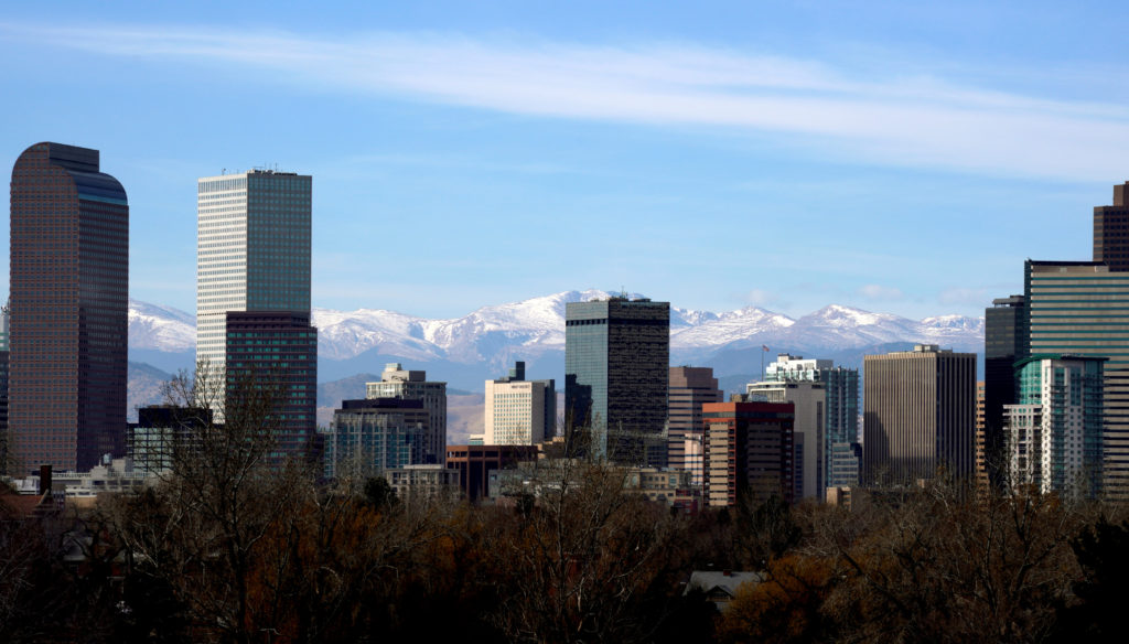 FILE PHOTO: The Continental Divide is seen in the background behind the downtown city skyline in Denver, Colorado, U.S., November 16, 2017. Photo by Rick Wilking/File Photo/Reuters