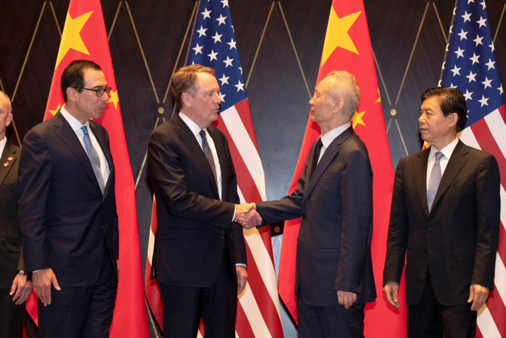 U.S. Trade Representative Robert Lighthizer shakes hands with Chine…