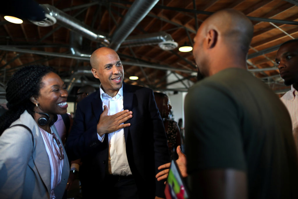 U.S. Senator and Democratic presidential candidate Cory Booker (C) talks to a supporter after speaking at a Gun Violence Prevention roundtable in Los Angeles, California, on August 22, 2019. Photo by Lucy Nicholson/Reuters