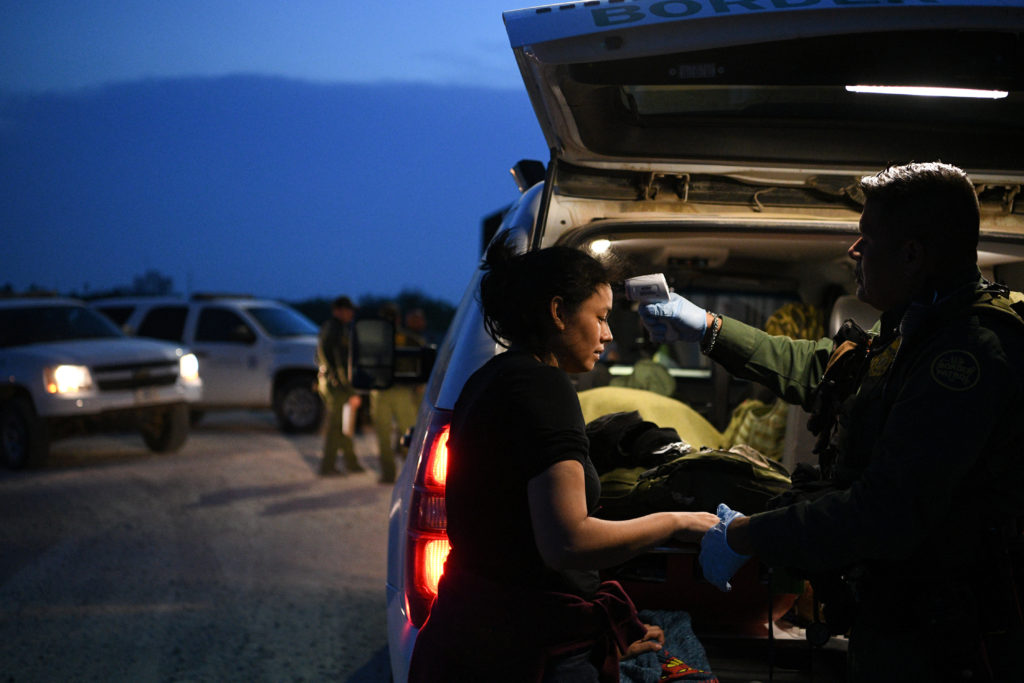 Nely, a Honduran migrant seeking asylum with her family, receives a medical evaluation from a U.S. Border Patrol agent trained as an emergency medical technician (EMT) after illegally crossing the Rio Grande and turning herself in to law enforcement in Hidalgo, Texas, U.S., August 23, 2019. Picture taken August 23, 2019. Photo by Loren Elliott/Reuters