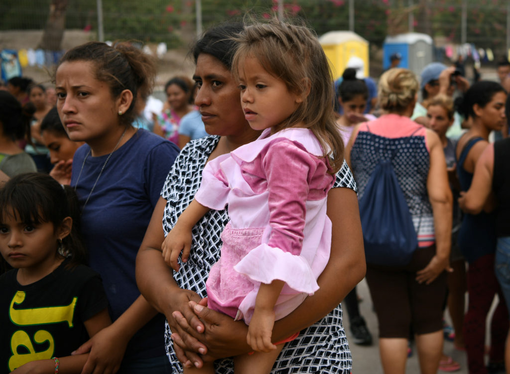 Migrants, many of whom are asylum seekers sent back to Mexico from the U.S. under Migrant Protection Protocols (MPP), line...