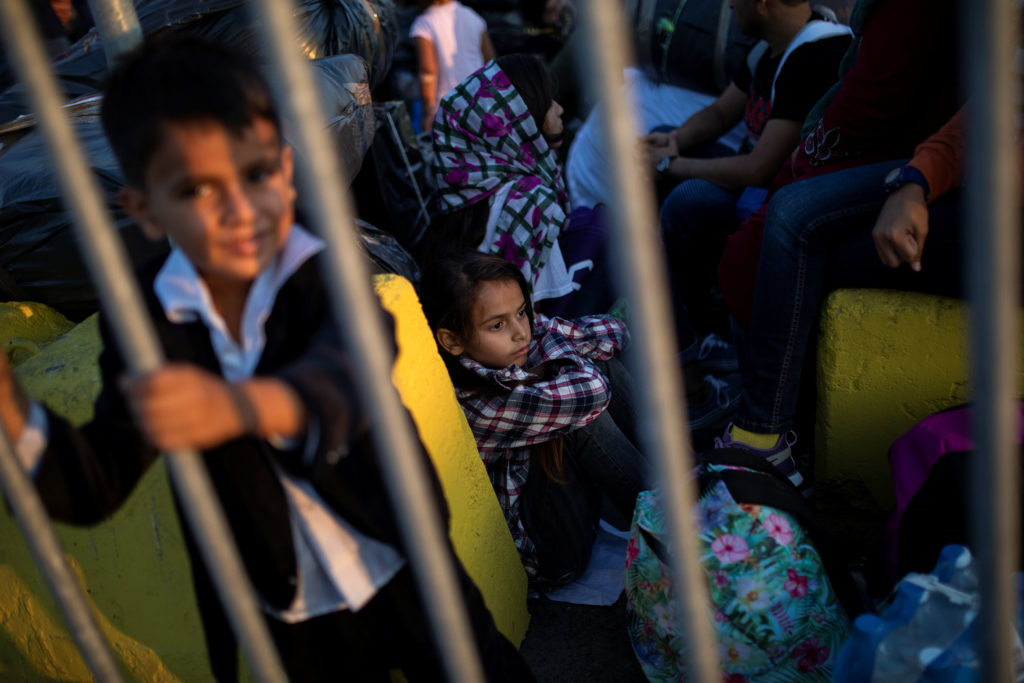 Children from Afghanistan wait to board a catamaran that will transfer them to the mainland, in Mytilene on the island of Lesbos, Greece, September 2, 2019. Photo by: Alkis Konstantinidis/Reuters
