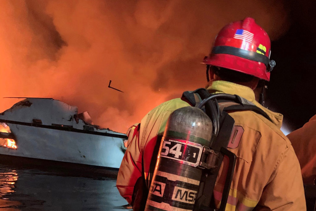 Ventura County Fire Department personnel respond to a boat fire on a 75-foot vessel off Santa Cruz Island, California, on Sept. 2, 2019. Photo by Ventura County Fire Department/Handout via REUTERS