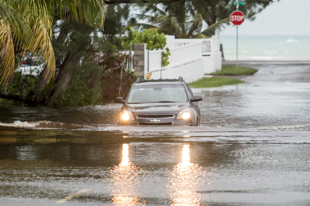 A car drives through a flooded street after the effects of Hurricane Dorian arrived in Nassau, Bahamas, September 2, 2019....