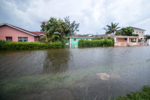 Houses line a flooded street after the effects of Hurricane Dorian arrived in Nassau, Bahamas, September 2, 2019. Photo by John Marc Nutt/Reuters