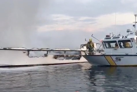 The damaged Conception commercial diving vessel (L) is seen after a fire broke out, near Santa Cruz Island, Southern California, U.S. September 2, 2019, in this still image taken from a social media video. Courtesy of Instagram @TOWBOATUS_VENTURA/Social Media via Reuters